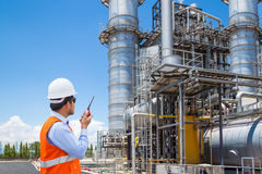 Engineer working at thermal power plant with talking on radio. Engineer working at thermal power plant with talking on the walkie-talkie for controlling work Stock Photography