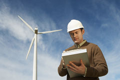Engineer Working At Wind Farm Stock Photo
