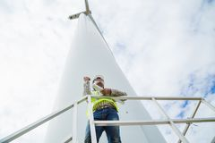 Engineer working at wind turbine site with blueprint Stock Images