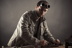 Engineer working for a workbench Stock Image