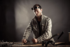 Engineer working for a workbench Royalty Free Stock Photography