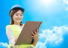 Engineer working and writing report Stock Photo