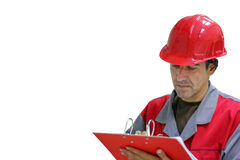 Engineer Writing on Clipboard. Engineer , isolated over white background. Worker in red uniform and safety helmet writing on clipboard Stock Image