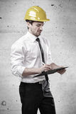 Engineer writing on a clipboard Stock Photo