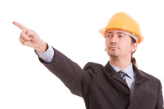 Engineer with yellow hat, pointing forward Stock Photography