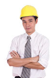 Engineer in yellow helmet with arms crossed Royalty Free Stock Photography