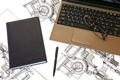Engineering. Diary lies near the laptop with glasses and a pen Stock Photo