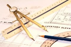 Engineering. Drawing objects set on rolled out engineering plans Stock Image