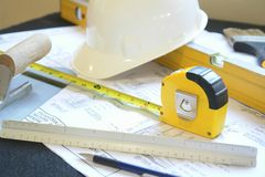 Engineering. Hard hat, blueprints and tools used in engineering and construction Royalty Free Stock Photography