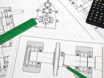 Engineering background. Ruler, calculator and pencil over blueprints Royalty Free Stock Photos