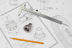 Engineering background. Analog caliper with pencil and part on drawings Royalty Free Stock Photos