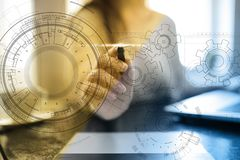 Engineering background with gears draft on virtual screen. Business innovation and modern technology concept. Engineering background with gears draft on virtual stock photos