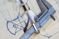 Engineering blueprint with glasses and gauge Royalty Free Stock Photo