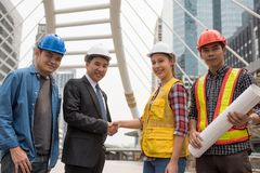 Handshake for Engineer project achievement in town. Engineering Businessman handshake with American engineer women after making international construction royalty free stock photography