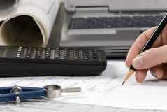Engineering Calculations. An Engineer calculates the final figures for a design Stock Images