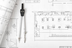 Engineering compass is on building plan. Royalty Free Stock Photography
