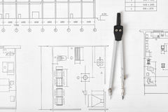 Engineering compass is on building plan. Royalty Free Stock Photo