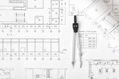 Engineering compass is on building plan. Royalty Free Stock Images