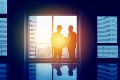 Engineering concept two men big office window stock photography