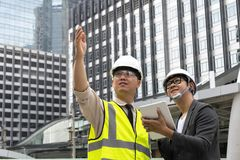 Engineering consultants with architects. stock photo
