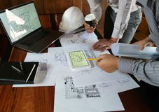Engineering, consulting, design, construction, with colleagues, plan design, details, industrial drawing and many drawing tools. Engineering consulting design royalty free stock photo