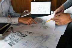 Engineering, consulting, design, construction, with colleagues, plan design, details, industrial drawing and many drawing tools. Engineering consulting design royalty free stock image