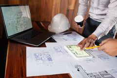 Engineering, consulting, design, construction, with colleagues, plan design, details, industrial drawing and many drawing tools. Engineering consulting design royalty free stock photography