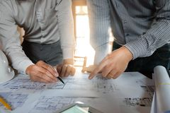 Engineering, consulting, design, construction, with colleagues, plan design, details, industrial drawing and many drawing tools. Engineering consulting design royalty free stock images