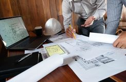 Engineering, consulting, design, construction, with colleagues, plan design, details, industrial drawing and many drawing tools. Engineering consulting design stock image