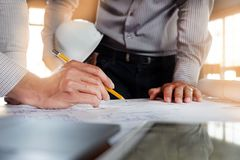 Engineering, consulting, design, construction, with colleagues, plan design, details, industrial drawing and many drawing tools. Engineering consulting design stock photo