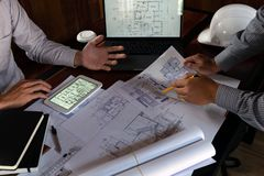 Engineering, consulting, design, construction, with colleagues, plan design, details, industrial drawing and many drawing tools. Engineering consulting design stock photography