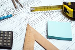 Engineering and design. Drawing and calculator, tape measure, ruler on the table stock photography