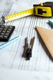 Engineering and design. Drawing and calculator, tape measure, ruler on the table royalty free stock photography