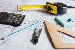 Engineering and design. Drawing and calculator, tape measure, ruler on the table stock photos