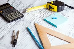 Engineering and design. Drawing and calculator, tape measure, ruler on the table stock image