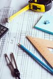 Engineering and design. Drawing and calculator, tape measure, ruler on the table royalty free stock images