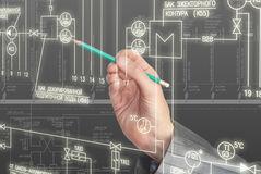 Engineering designing. The engineer-designer develops the scheme of automation of connection of a power electric equipment Stock Photography
