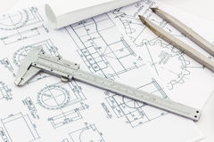Engineering dividers Tools and Vernier scale on blueprint backgr Royalty Free Stock Image