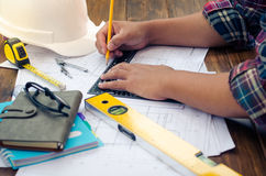 Engineering draftsman working in the office. Engineering draftsman working in the office royalty free stock images