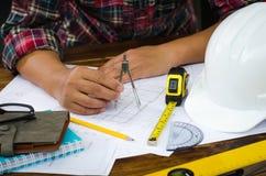 Engineering draftsman working in the office. Engineering draftsman working in the office stock images