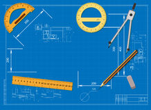 Engineering drawing on a blue background and tools to measure Royalty Free Stock Images