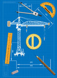 Engineering drawing on a blue background and tools to measure Stock Image