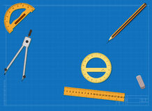 Engineering drawing on a blue background and tools Stock Photos