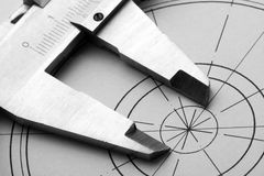 Engineering drawing and caliper Stock Photo