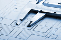 Engineering drawing and caliper Stock Images