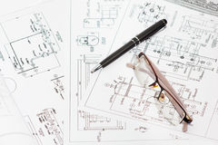 Engineering drawings. Engineering drawings with pen and eyeglasses royalty free stock photography