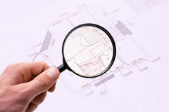 Engineering drawings. Magnifier glass and paper part of architectural project Stock Image