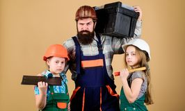 Engineering education. construction worker assistant. Father and daughter in workshop. Bearded man with little girls. Engineering education. construction worker royalty free stock image