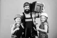 Engineering education. construction worker. Repairman in uniform. Father and daughter in workshop. Bearded man with. Engineering education. construction worker royalty free stock image