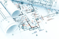 Engineering electricity technical project with rolls of architec. Engineering electricity technical drawing with rolls of architectural blueprints Stock Photo